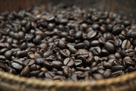 african basket: Roasted coffee beans in the wicker basket.