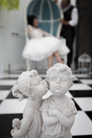 unity small flower: Sculpture of bride and groom. Stock Photo