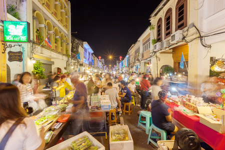 town: Phuket, Thailand - October 4, 2015: Unidentified tourists are shopping at old town night market (Walking street) in Phuket, Thailand.