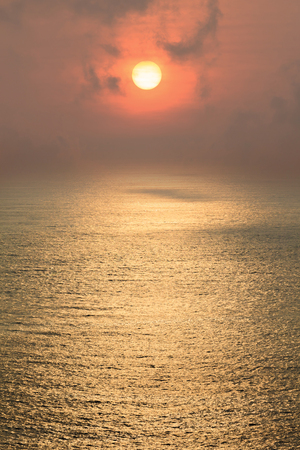 sea pollution: Beautiful sunset above the sea in air pollution day. Stock Photo