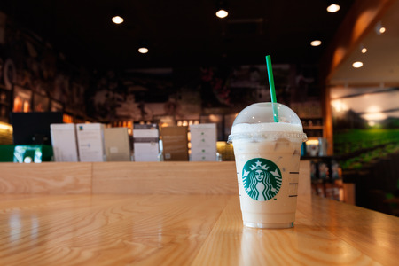 Phuket, Thailand - September 30, 2015: Glass of Starbuck coffee ice cappuccino blended beverages served at wooden table in starbuck shop. Editorial
