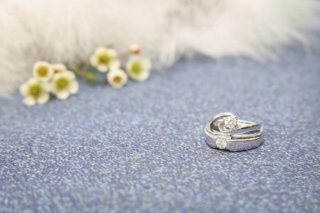 weddingrings: Wedding rings on luxury sofa with beautiful flowers. Stock Photo
