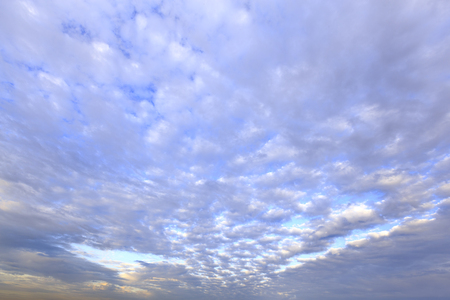 fluffy: White fluffy clouds in the blue sky.