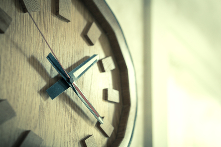 oldened: Time passing over the face of home office Wall Clock. Concept photo of time, timming,business, busy,deadline. - (Selective focus  Split tone) Stock Photo