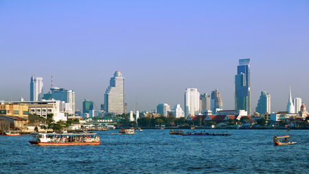 plano: View of Bangkok downtown and transportation in the Chao Phraya River  during sundown. Stock Photo
