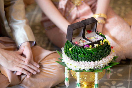 affiance: Betrothal and wedding rings  Traditional Thai wedding. - (Selective focus)