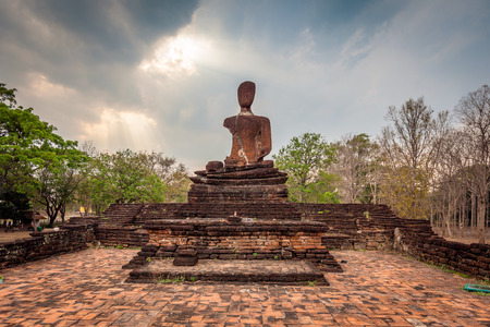 Old buddha statue in the Kamphaeng Phet Historical Park, Thailand. - (Selective focus)