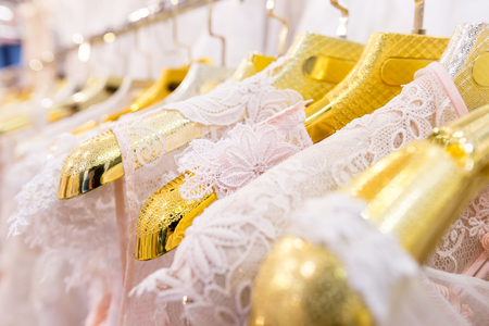 Beautiful wedding dresses on a hanger.