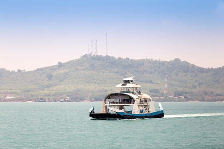 ferry boat: Tourists and cars loaded on ferry boat and heading to Koh Chang Island. Koh Chang island is the second largest island in Thailand. Stock Photo