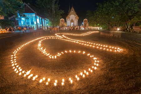 bhumibol: Candle light was arranged in a number 9. It mean a number of the King of Thailand for Thai religious day Phansa took place at Wat tha khanun in Kanchanaburi, Thailand.