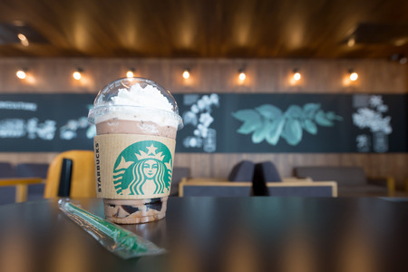 Nonthaburi, Thailand - June 16, 2016: Glass of Starbuck Coffee Frappuccino Blended Beverages on a table. Starbucks is the worlds largest coffee house with over 20,000 stores in 61 countries.