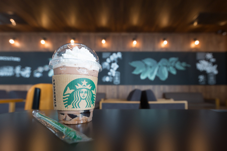 Nonthaburi, Thailand - June 16, 2016: Glass of Starbuck coffee ice blended beverages served on table in starbuck coffee shop.