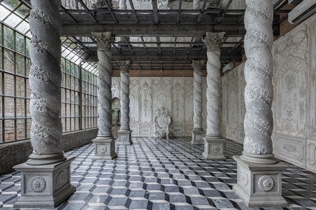 corinthian: Corinthian columns colonnade leading to the luxurious armchair. - Photography studio Stock Photo
