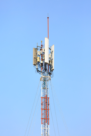 Worldwide Communication, Satellite and other antenna network against clear blue sky.