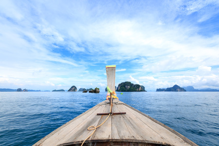 Traditional long tail boat on the way to famous beach in Krabi, Southern Thailand. Stock Photo