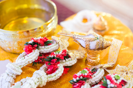 Conch was decorated with gold, used as the equipment for Thai wedding style. Stock Photo
