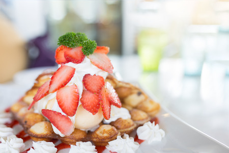 Strawberry Hong Kong waffle or bubble waffle with vanilla ice cream and wip cream.