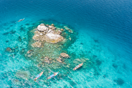 Aerial view of unidentified tourists snorkeling activity on tropical island near Lipe Island, Satun, Thailand. Фото со стока