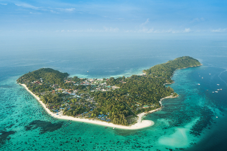 High aerial overview of entire tropical Lipe Island and Andaman Sea in Satun province, Thailand.