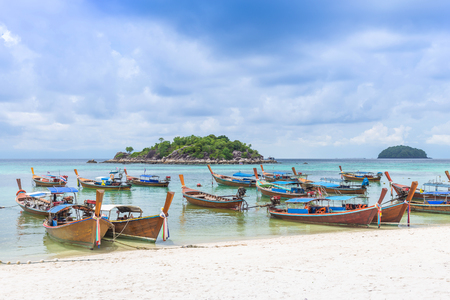 Group of Thai traditional longtail boats on white sand beach at Sunrise beach, Lipe Island, Thailand. Фото со стока