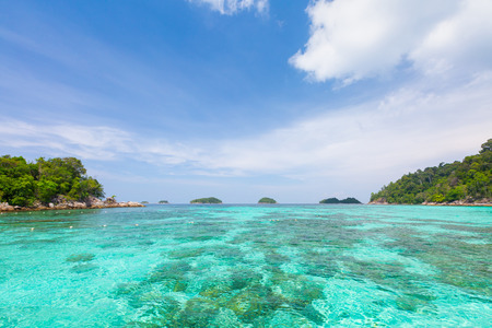 Crystal turquoise green sea ocean clear water and mountain at Lipe Island Satun Thailand. Фото со стока