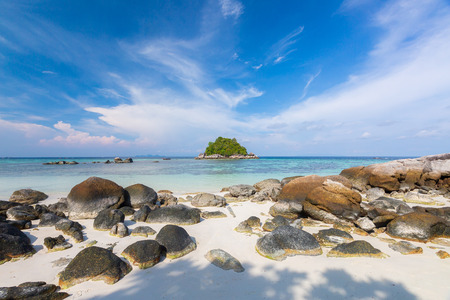 Beautiful tropical white sand and rock near the Serendipity Beach Resort at Lipe Island, Satun Province, Thailand.