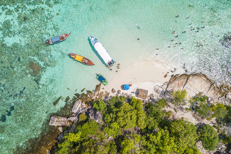 Aerial view of Unidentified tourists enjoy and relax on the white sand beach at Koh Rok Roy or Koh Rokroy (Rok Roy Island), Lipe Island, Tarutao National Marine Park, Satun Province, Thailand. Фото со стока