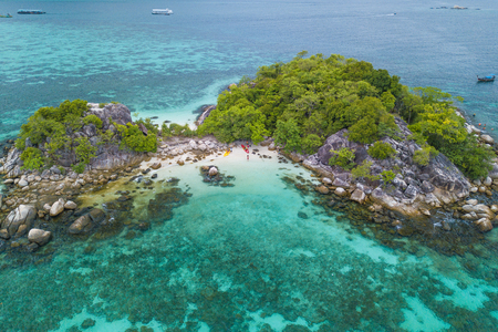 Aerial view of tropical white sand beach and crystal blue sea near the Lipe Island. Kra Island is a group of small rocky islets in the southern area of Andaman sea of Thailand.