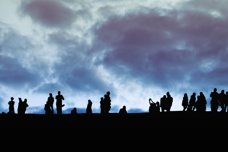 Silhouette image of group of unidentified tourists on sunset time at high view point background. Can be use for travel, relax, holiday, season concept. Фото со стока