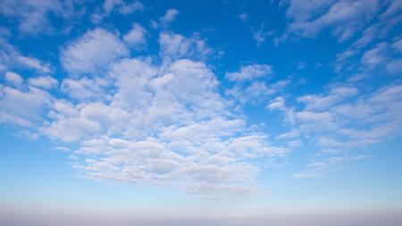 The vast blue sky and clouds sky background.