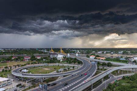 Aerial view of Bangkok skyline and beautiful bridge panorama at Chao Phraya River Bangkok Thailand at sunset. Maha Chesadabodindranusorn Bridge is a bridge Nonthaburi District in Nonthaburi Province.