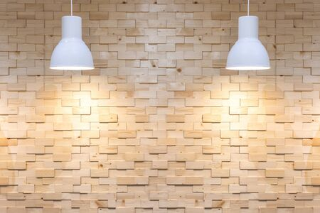 Interior empty wooden wall background with lamps over.