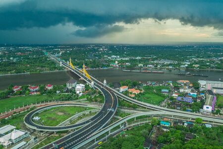 Aerial view of Bangkok skyline panorama and Chesadabodindranusorn Bridge in capital. Modern buildings condominium at Chao Phraya River Bangkok Thailand at sunset. Stock Photo