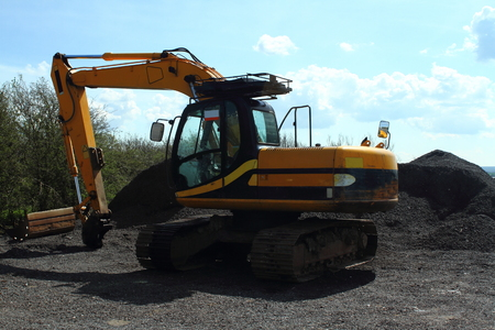 diggers: Yellow Digger with pile of loose stones