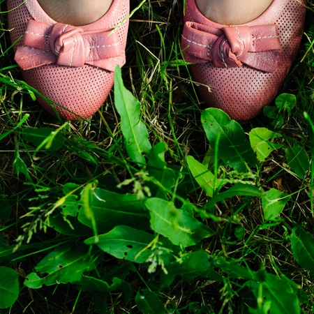 Shoes on meadow photo