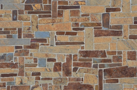 gray texture: Stone wall in multi colors of  gray, brown, and tan. Stock Photo