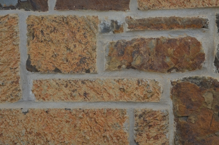 tans: Stone wall with colors of brown, rust, tan, and grays Stock Photo