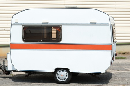 small travel trailer white orange stripe