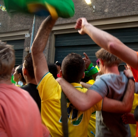 Brazilian super celebrating the World Cup soccer in the streets of amsterdam Editorial