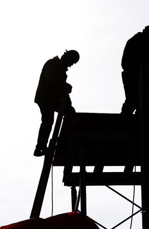 silhouetted construction worker