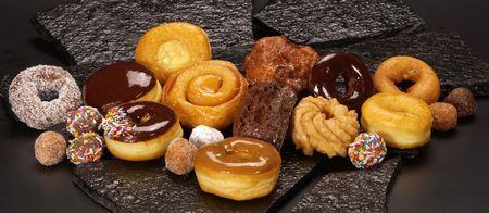 Donuts on black slate                    Stock Photo