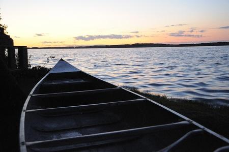 Sunset and canoe on Manitoba Lake