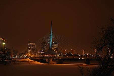 Esplanade Reil Bridge with various colours of lighting , Winnipeg, Manitoba,