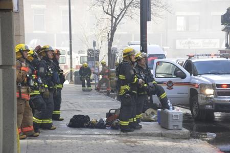 firemen working a major fire o Albert St  in Winnipeg, Manitoba