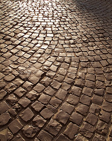 cobble: Cobble stone street background at sunset, Italy