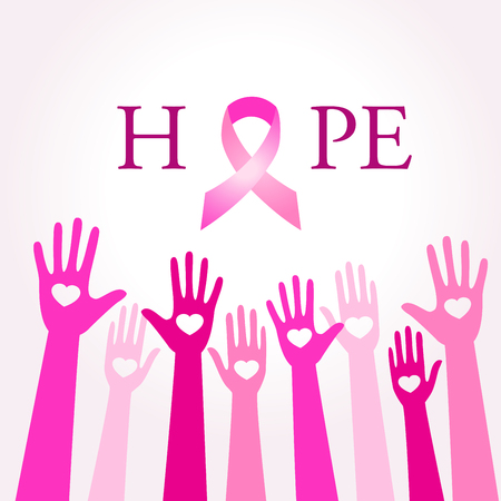 Diverse hands joining for breast cancer awareness