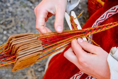 Woman hands weaving traditional belt Stock Photo