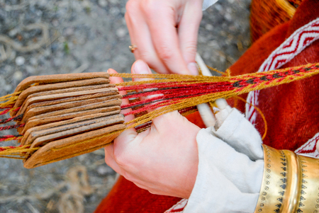 WEAVER: Woman hands weaving traditional belt Stock Photo