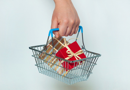 A shopping cart with giftboxes, sale concept