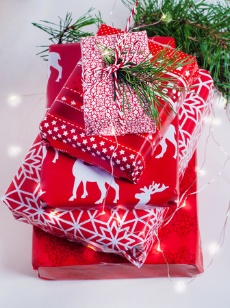 Pile of nicely packed christmas gifts on white background
